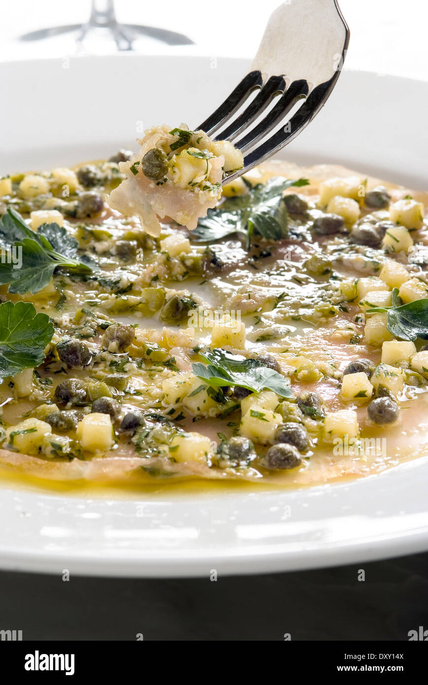 Veal carpaccio with capers and parmesan - Stock Image