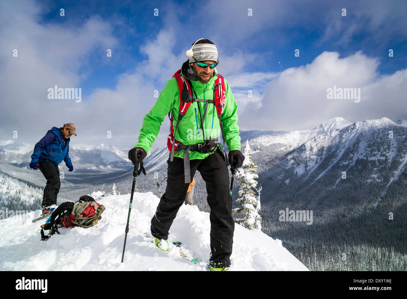 Lead mountain and back country ski guide on ridge top, North Cascade Mountains, Washington state, USA - Stock Image