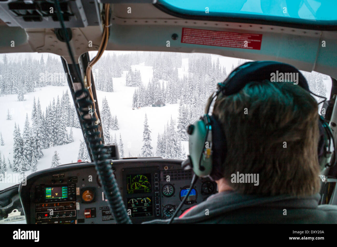View from helicopter flying back country skiers into remote wilderness yurt, North Cascades, Washington state - Stock Image