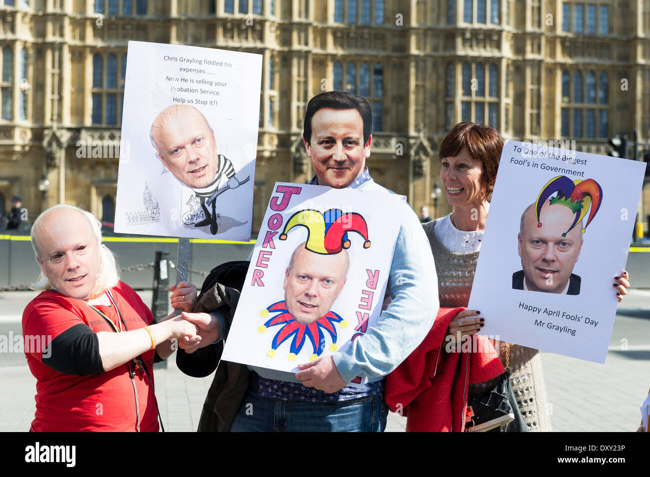 London, UK. 1st April 2014. Protesters outside the Houses of Parliament wear masks of David Cameron and Chris Grayling as part of the joint demonstration by probation officers and legal aid solicitors. Photographer: Gordon Scammell/Alamy Live News - Stock Image