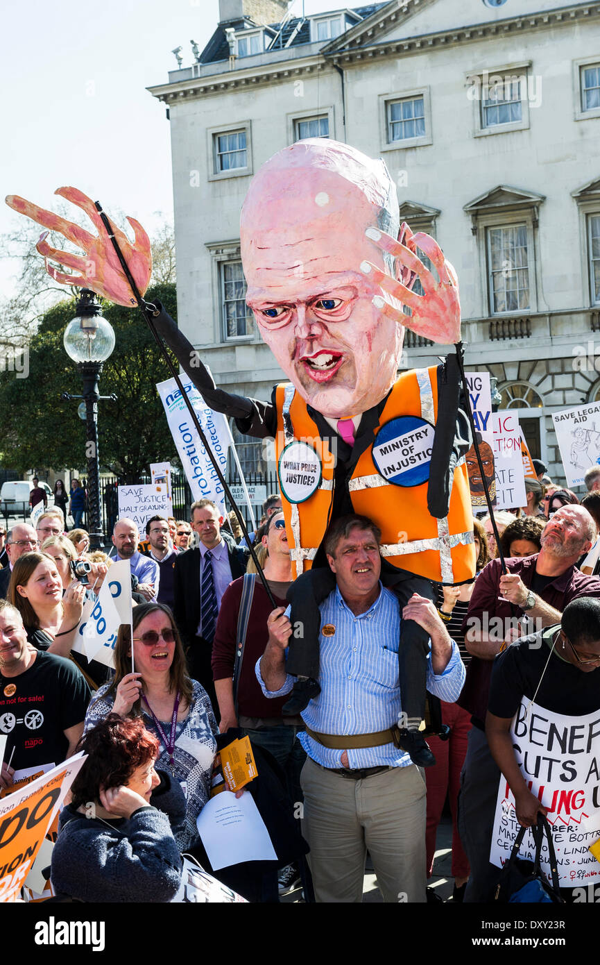 London, UK. 1st April 2014.  A large effigy of Chris Grayling, the Justice Secretary, joins the massed protesters as part of the joint demonstration by probation officers and legal aid solicitors. Photographer: Gordon Scammell/Alamy Live News - Stock Image