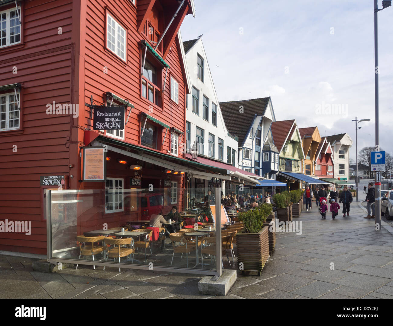 Outdoors restaurants in old warehouses, cafés and bars attract visitors whenever the sun puts in an appearance, Stavanger Norway - Stock Image