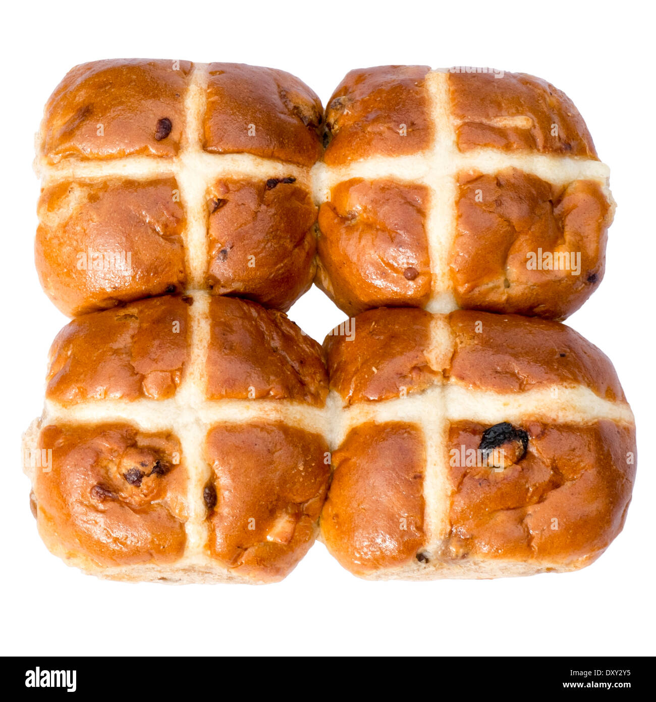 Hot cross buns cut out against a white background. - Stock Image