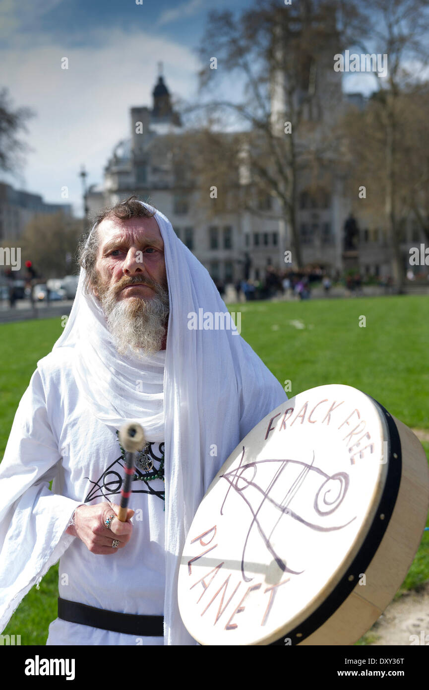 London, UK. 1st April 2014. 1st April, 2014  A druidic protester plays a drum as part of a small anti-fracking protest - Stock Image