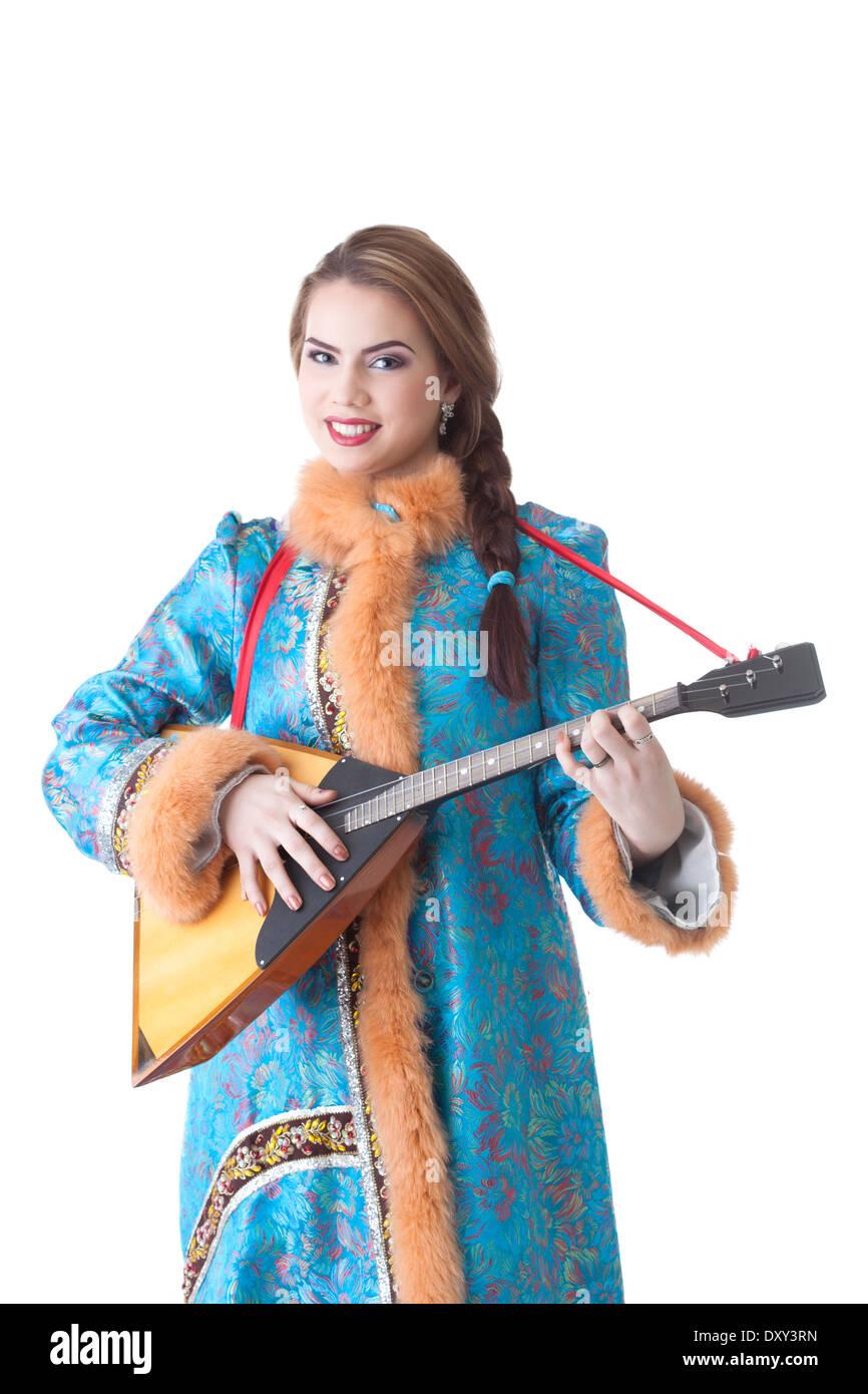 Charming Russian girl playing balalaika in studio - Stock Image