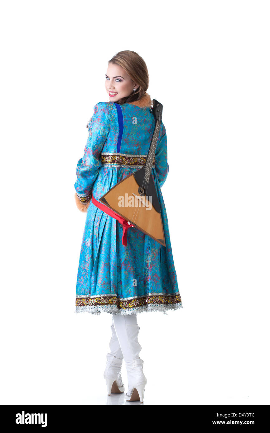 Cheerful Russian girl posing with balalaika - Stock Image