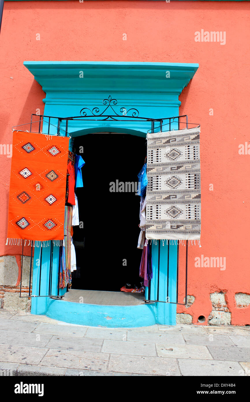 Turquoise Door And Red Walls Shop With Rugs Hanging Up Outside
