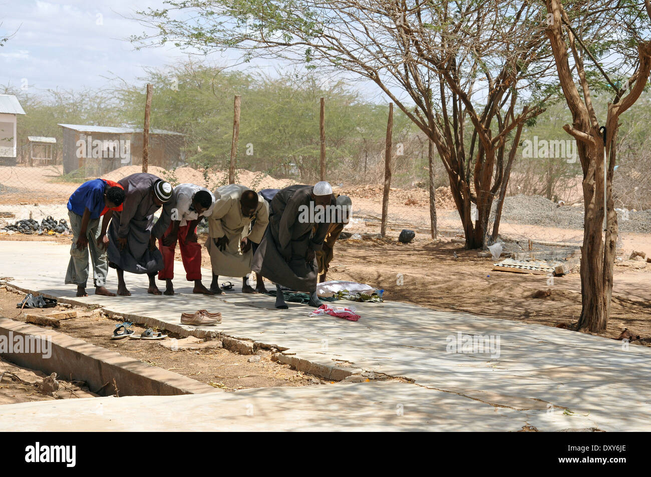 DADAAB, SOMALIA-AUGUST 08: Muslims praying in Dadaab refugee camp. Hundreds of thousands of refugees in the camp that is located - Stock Image