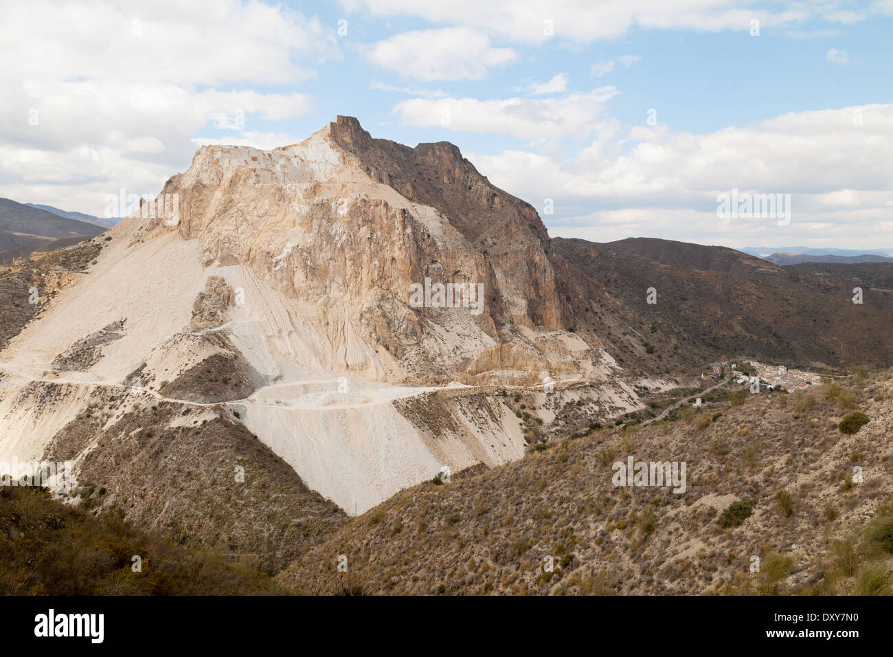 An open white marble mine on a mountain in the Sierra de los Fibrales, by the town of Cobdar, Andalusia Spain Europe - Stock Image