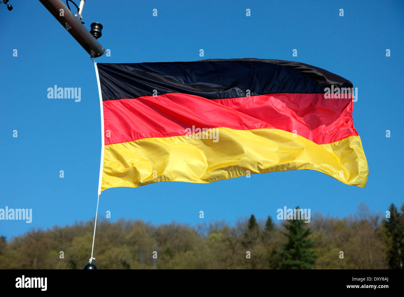 German flag flying on the MV River Beatrice sailing on the River Danube - Stock Image