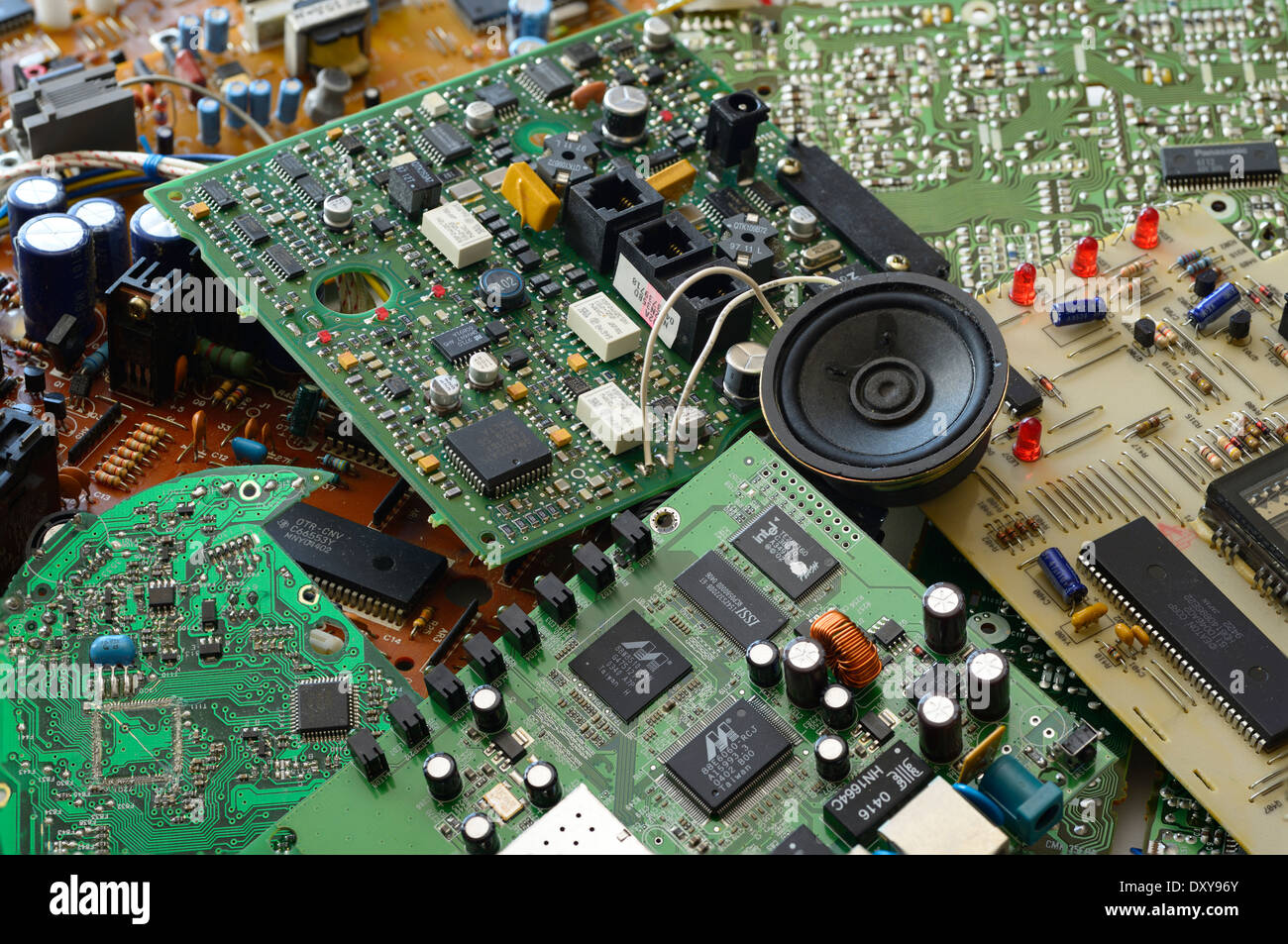 Collection of junk electronic components with microchips and integrated printed circuit boards - Stock Image