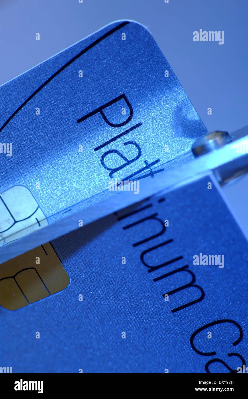 Cutting Platinum Card with Scissors - Stock Image