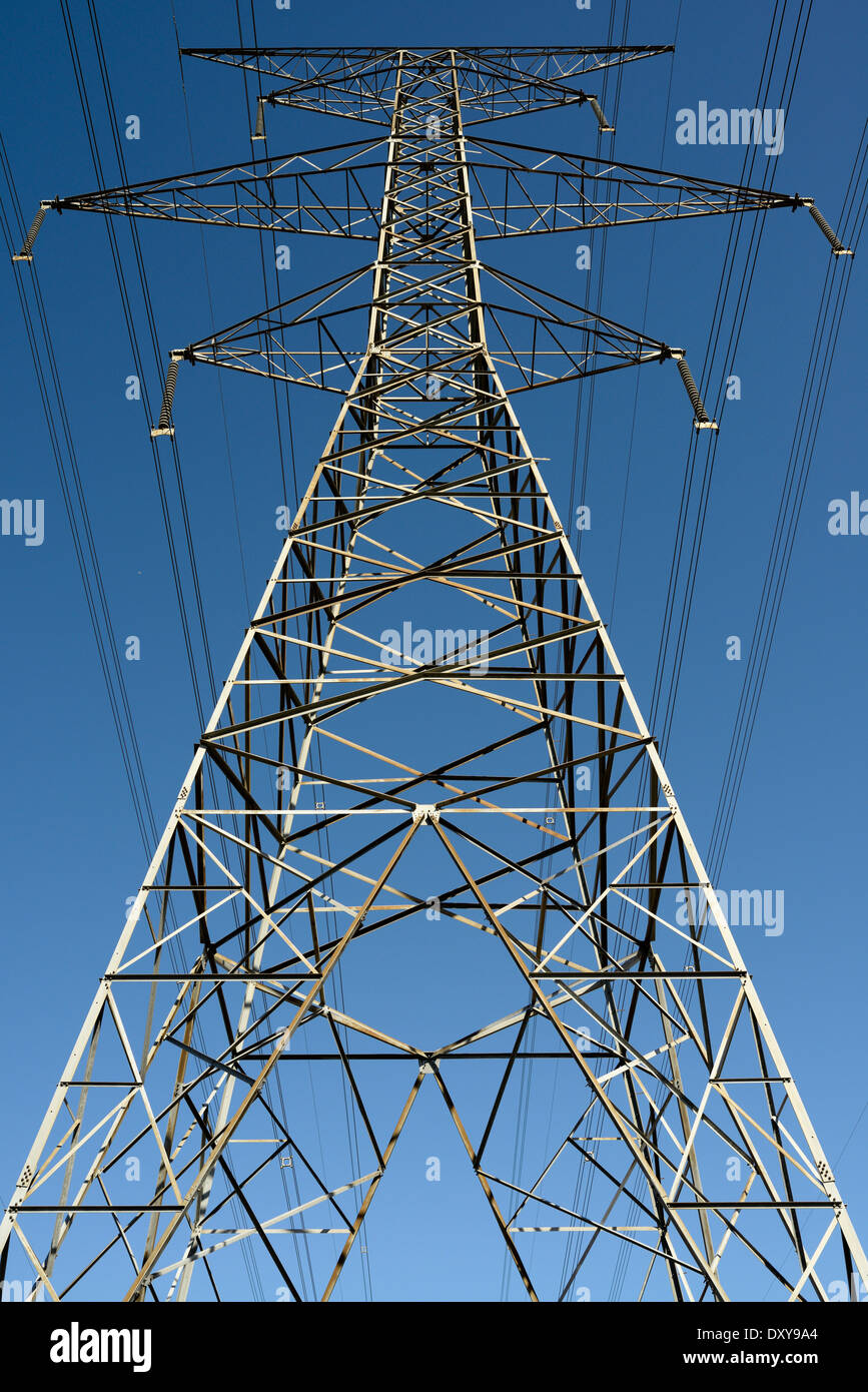 Steel lattice suspension electric tower with high tension power lines against a blue sky Ontario Hydro - Stock Image