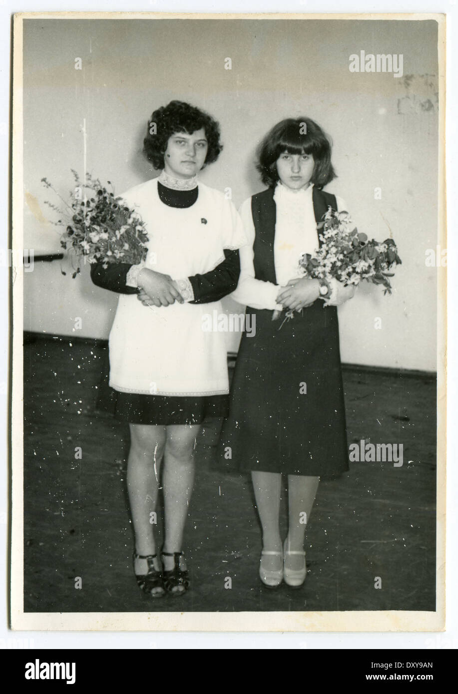 USSR - CIRCA 1970s : An antique photo shows two schoolgirl. Stock Photo