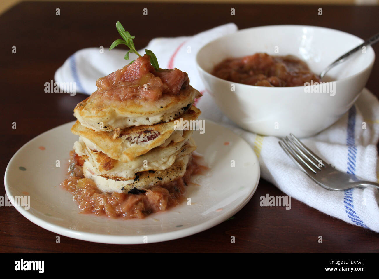 Spelt Pancakes with Coconut Bacon and Stewed Tarragon Rhubarb - Stock Image