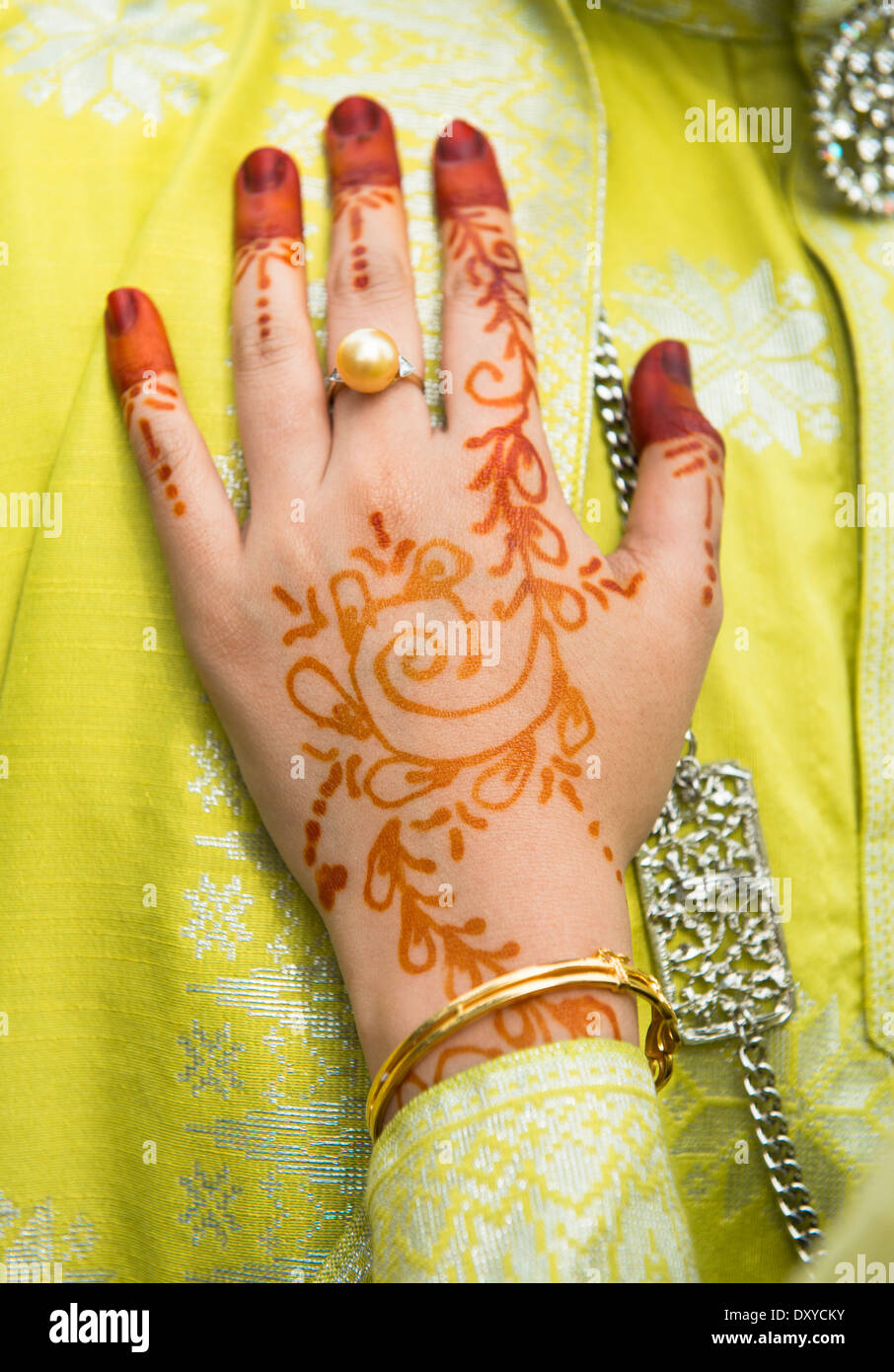 A Malay bride showing her beautiful Henna hand decorations. - Stock Image