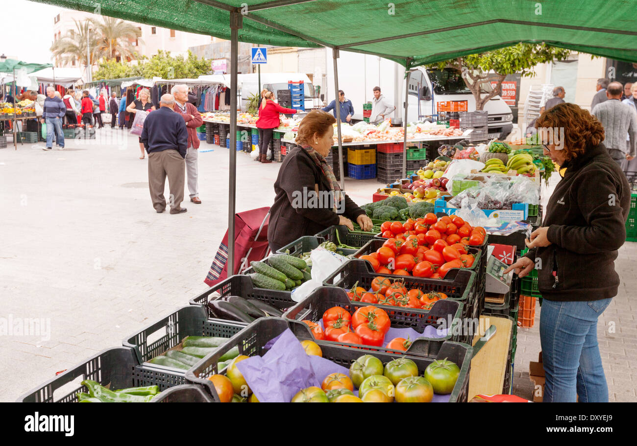People shopping at a vegetable stall in a village market, Turre, Almeria, Andalusia, Spain Europe - Stock Image