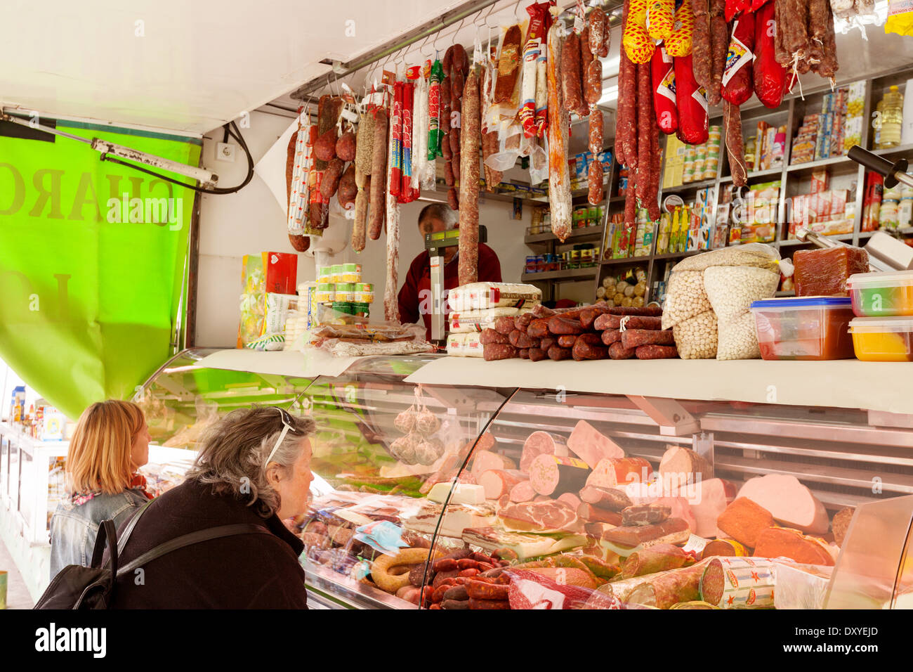 People shopping for meat at the meat stall, Turre village market, Almeria, Andalusia, Spain Europe - Stock Image