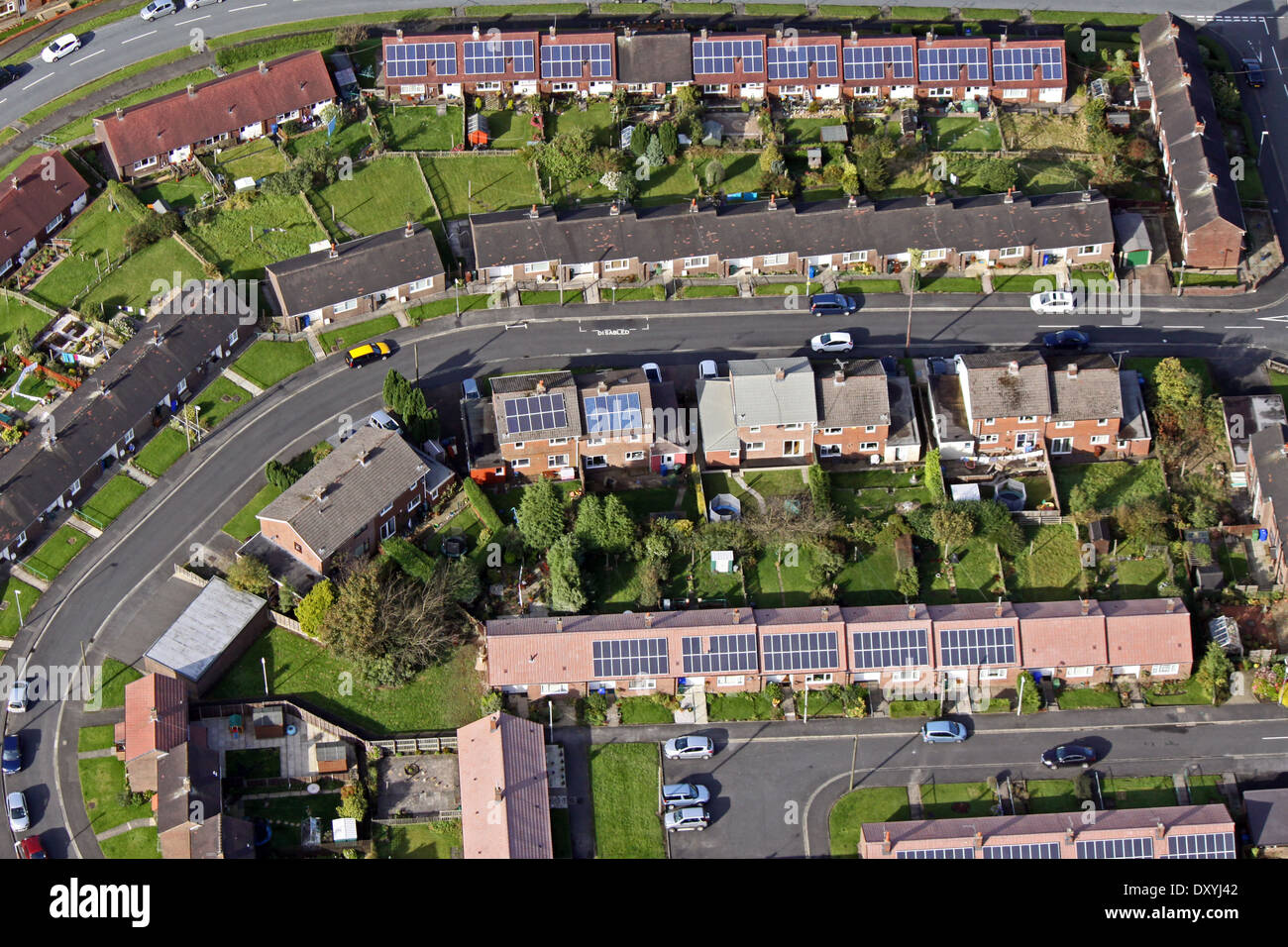 aerial view of modern and older houses and bungalows with solar panels on the roof - Stock Image