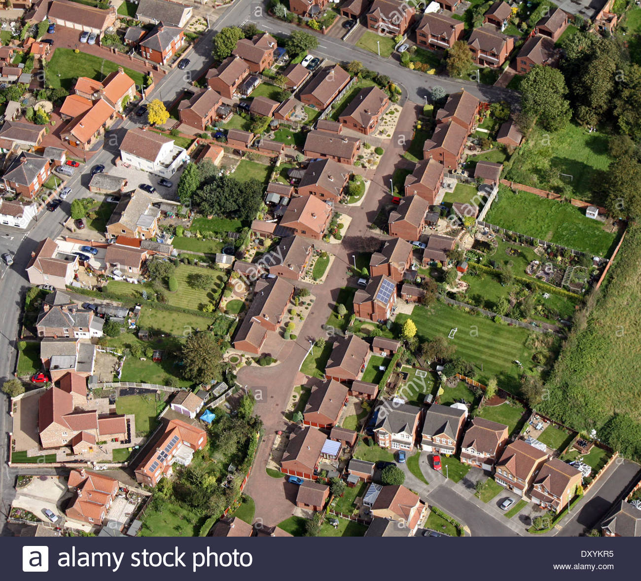 aerial view of modern housing with solar panels on the roof - Stock Image