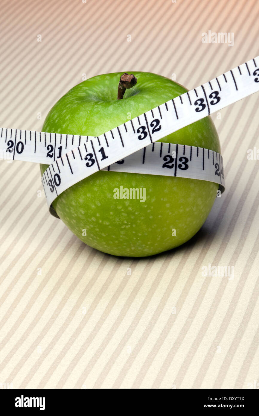 Dieting is a special course of food to which a person restricts themselves, either to lose weight or for medical reasons: - Stock Image