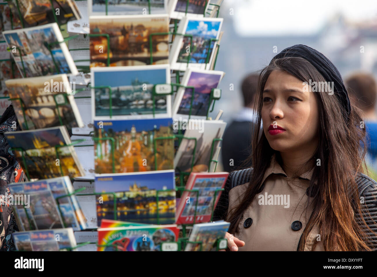 Prague shopping, A young Asian woman chooses postcards on Wenceslas Square, Prague Czech Republic - Stock Image