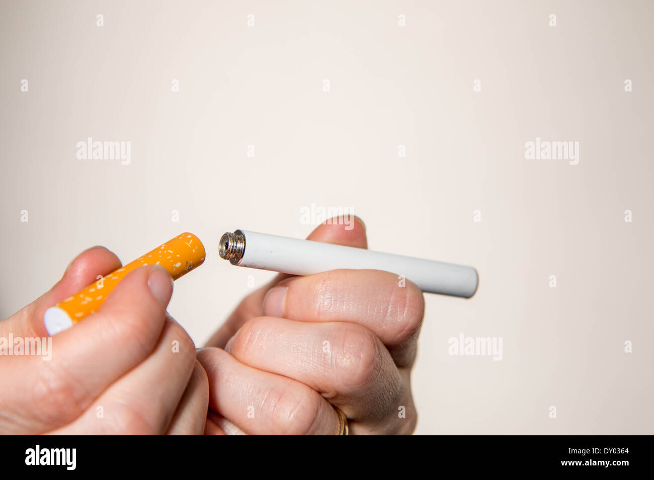 hands holding an electronic cigarette - Stock Image