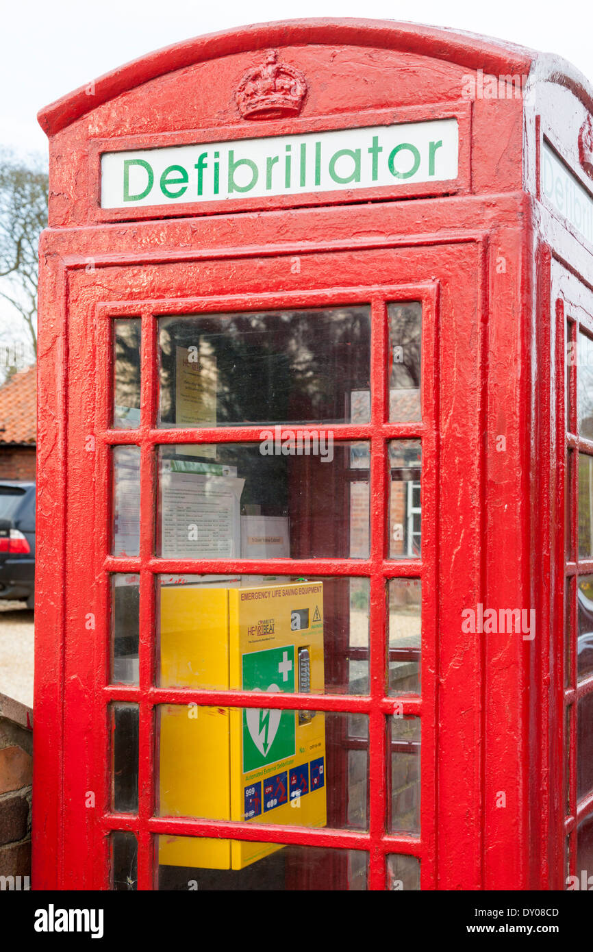 Defibrillator. Old telephone box now used to keep emergency life saving equipment in the community, Nottinghamshire, England, UK - Stock Image