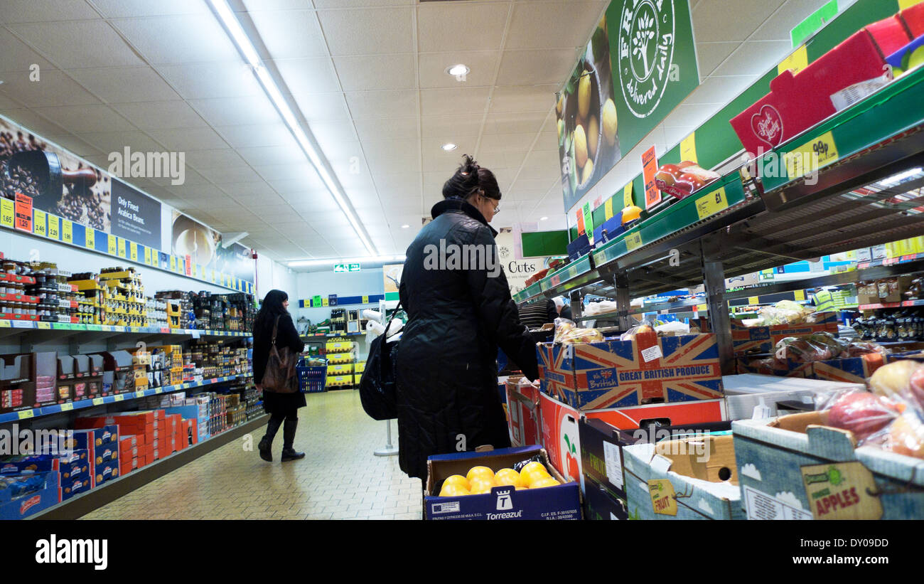 Chinese woman shopper shopping for fruit and vegetables in Lidl supermarket Cardiff Wales UK  KATHY DEWITT - Stock Image
