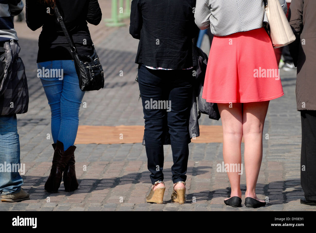 London, England, UK. Women's legs - contrasting in trousers and skirt - Stock Image