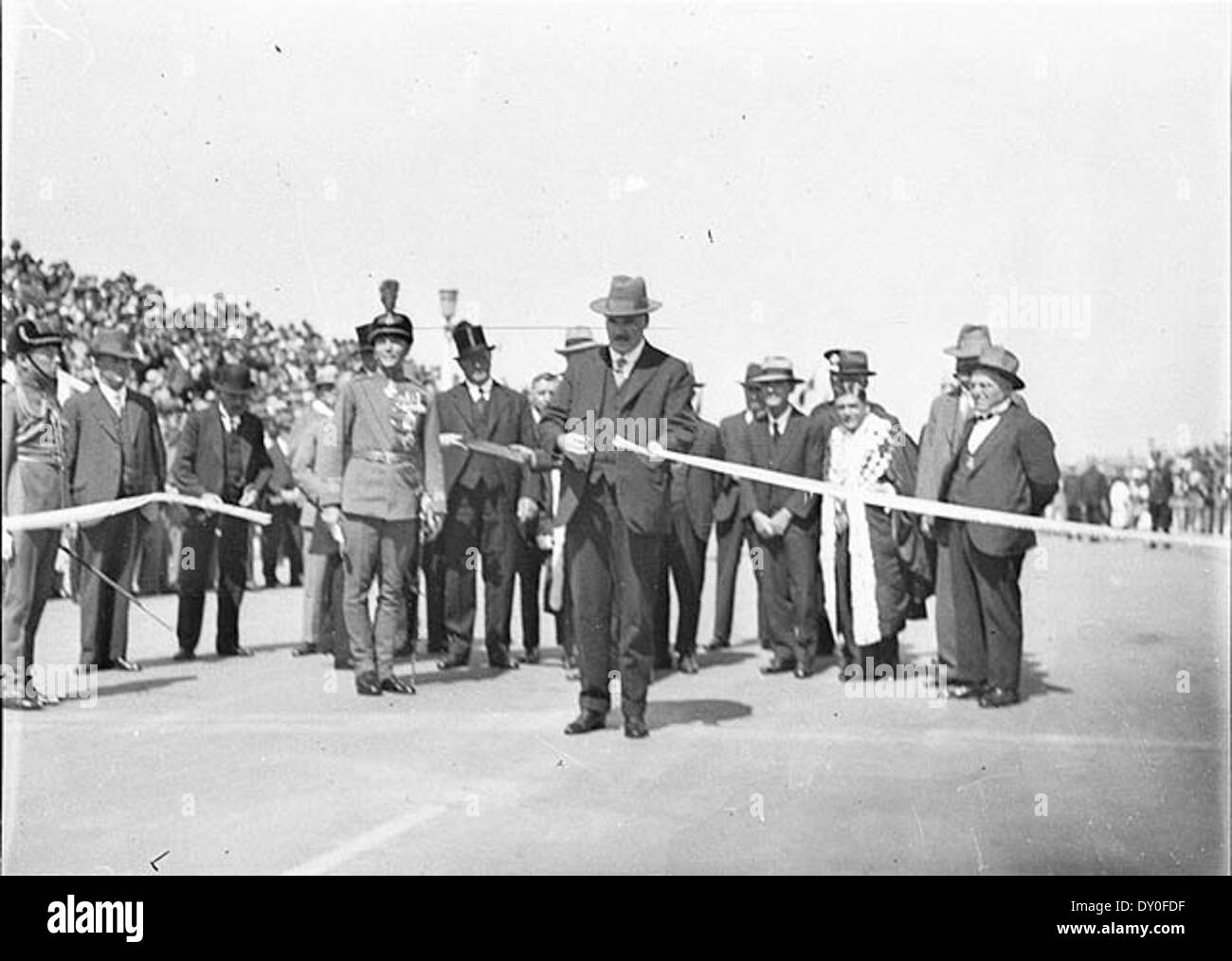 Jack Lang, watched by Sir Philip Game, cuts official ribbon, 19th March 1932 / photographed by Sam Hood - Stock Image