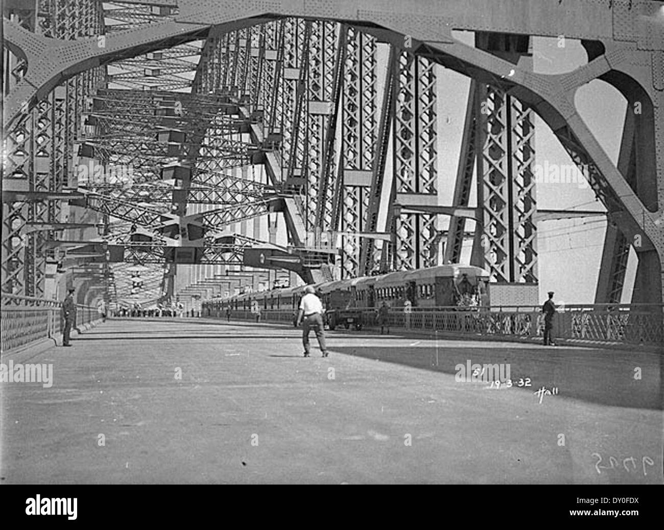 Harbour Bridge with first electric train before official opening, Sydney Harbour Bridge Celebrations, 1932 / photographed by Hall & Co - Stock Image
