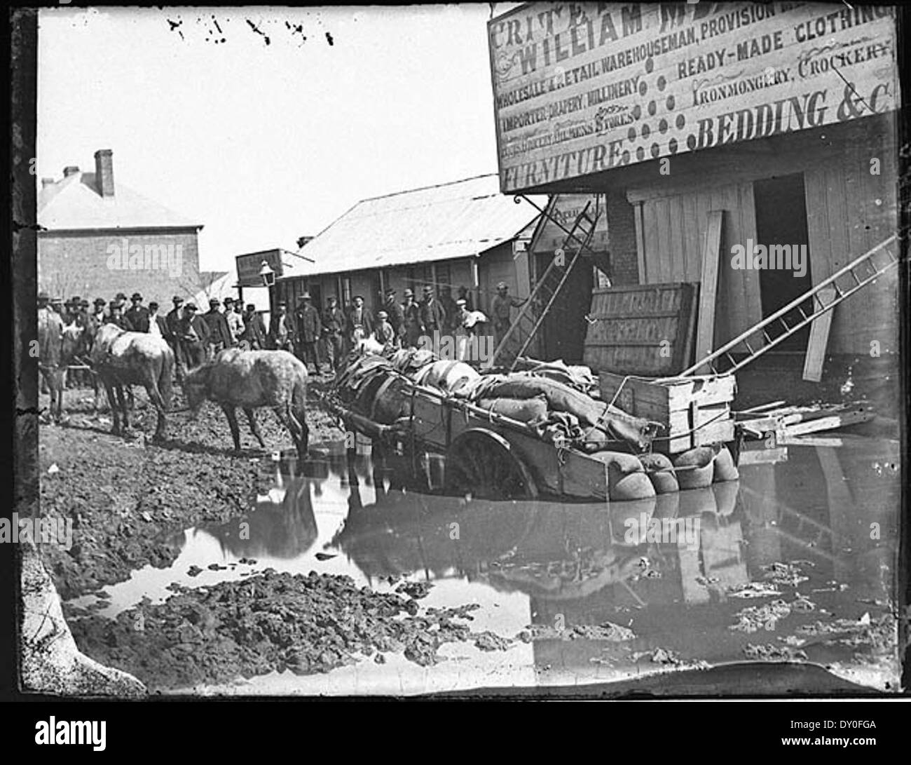 Horse and cart bogged in what was once a gold digging outside Meares flooded Criterion Store, Clarke Street, Hill End, Winter 1872 / American & Australasian Photographic Company - Stock Image