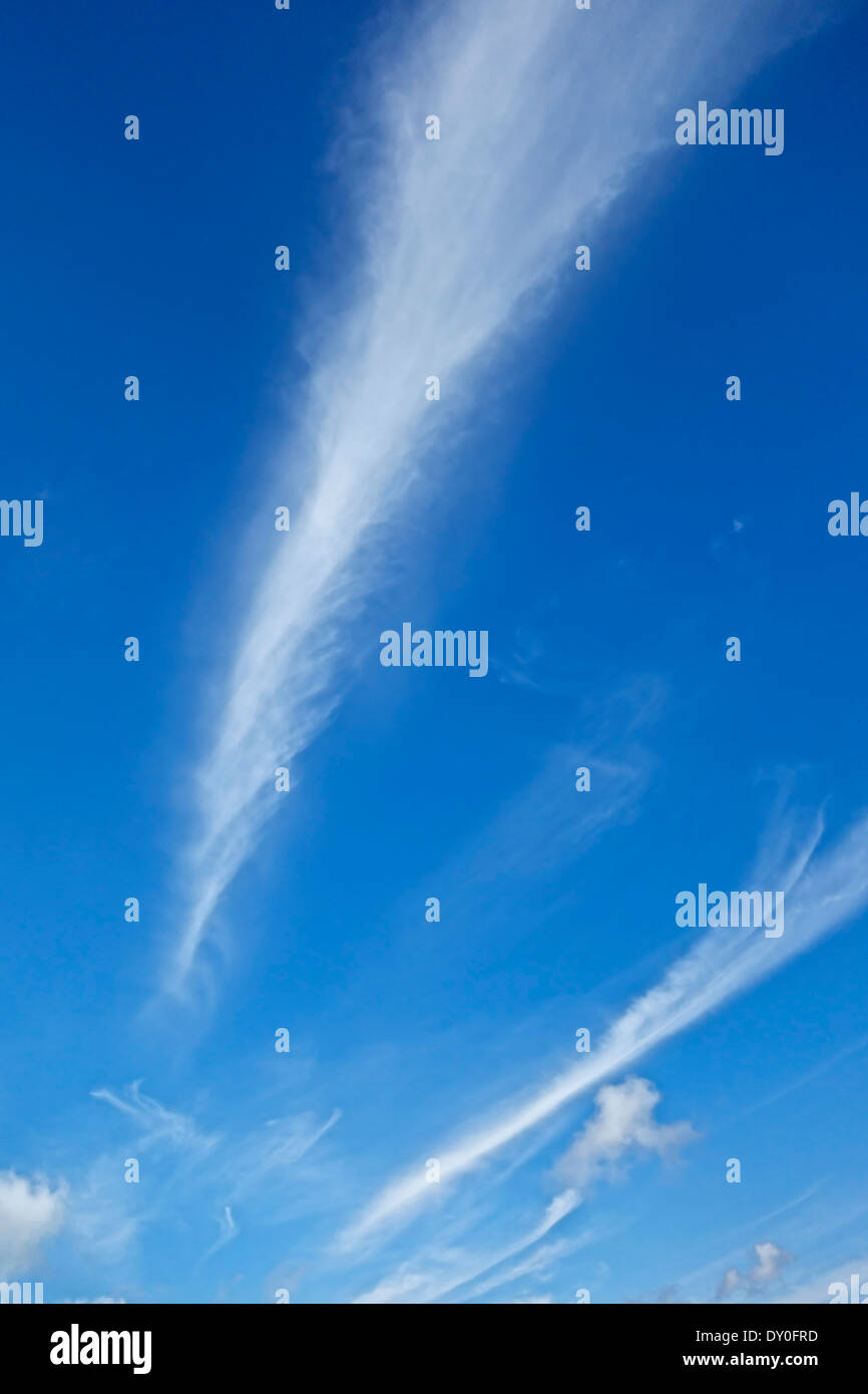 Vapour trails (contrails) in a clear blue sky - Stock Image