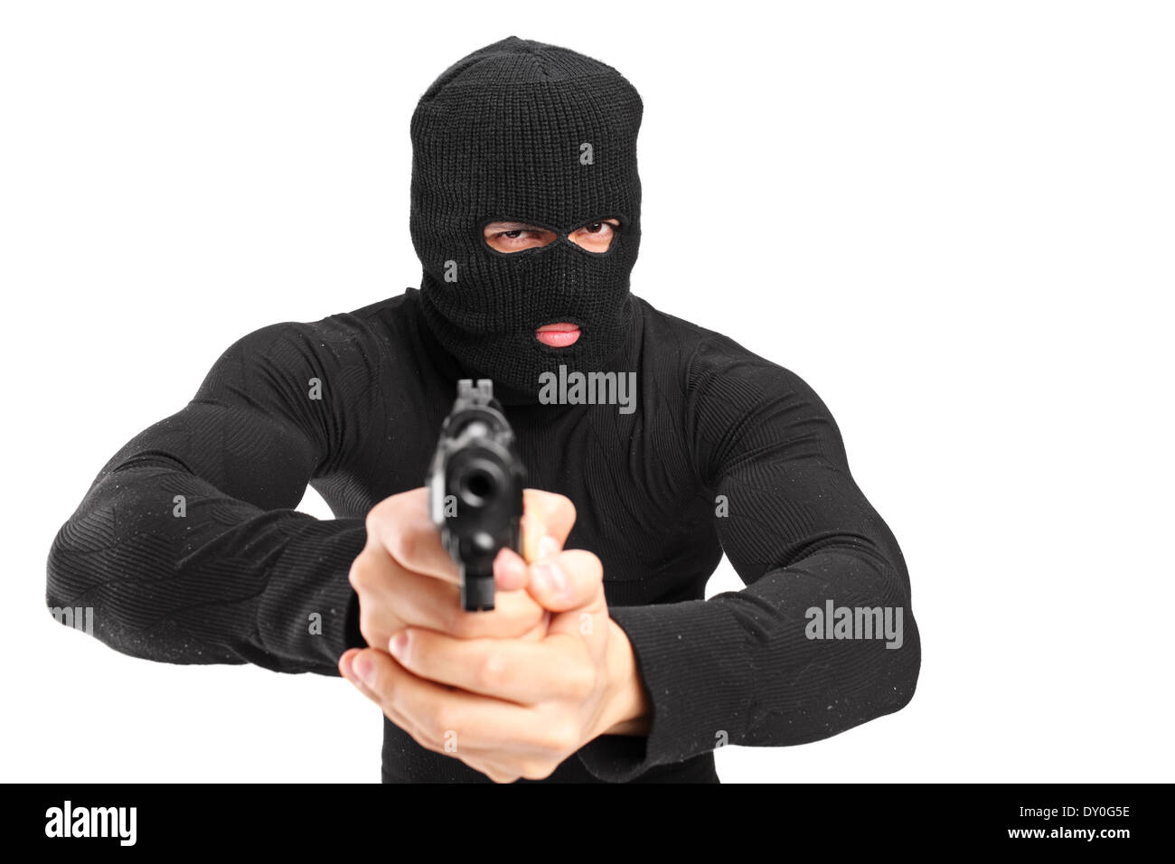 Man with a mask holding a gun - Stock Image