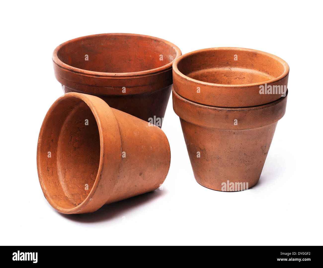Old used flower pots made of clay, isolated on white with natural shadows. - Stock Image