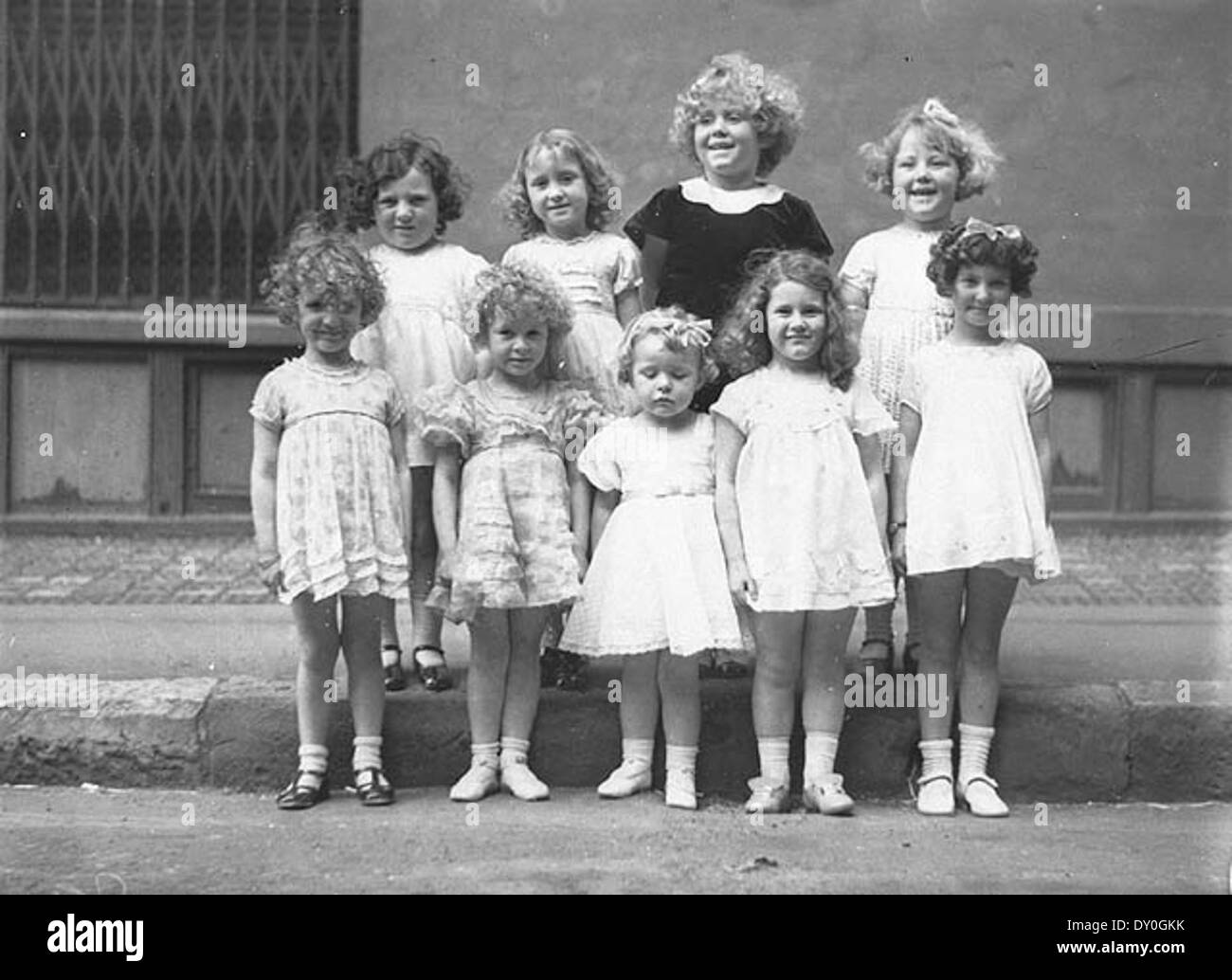 Nine girls in a Fox Films and Daily Telegraph Shirley Temple look-alike contest (100 pounds first prize won by Sybil Frederick of Marrickville), Sydney, 2 October 1934 / by Sam Hood - Stock Image