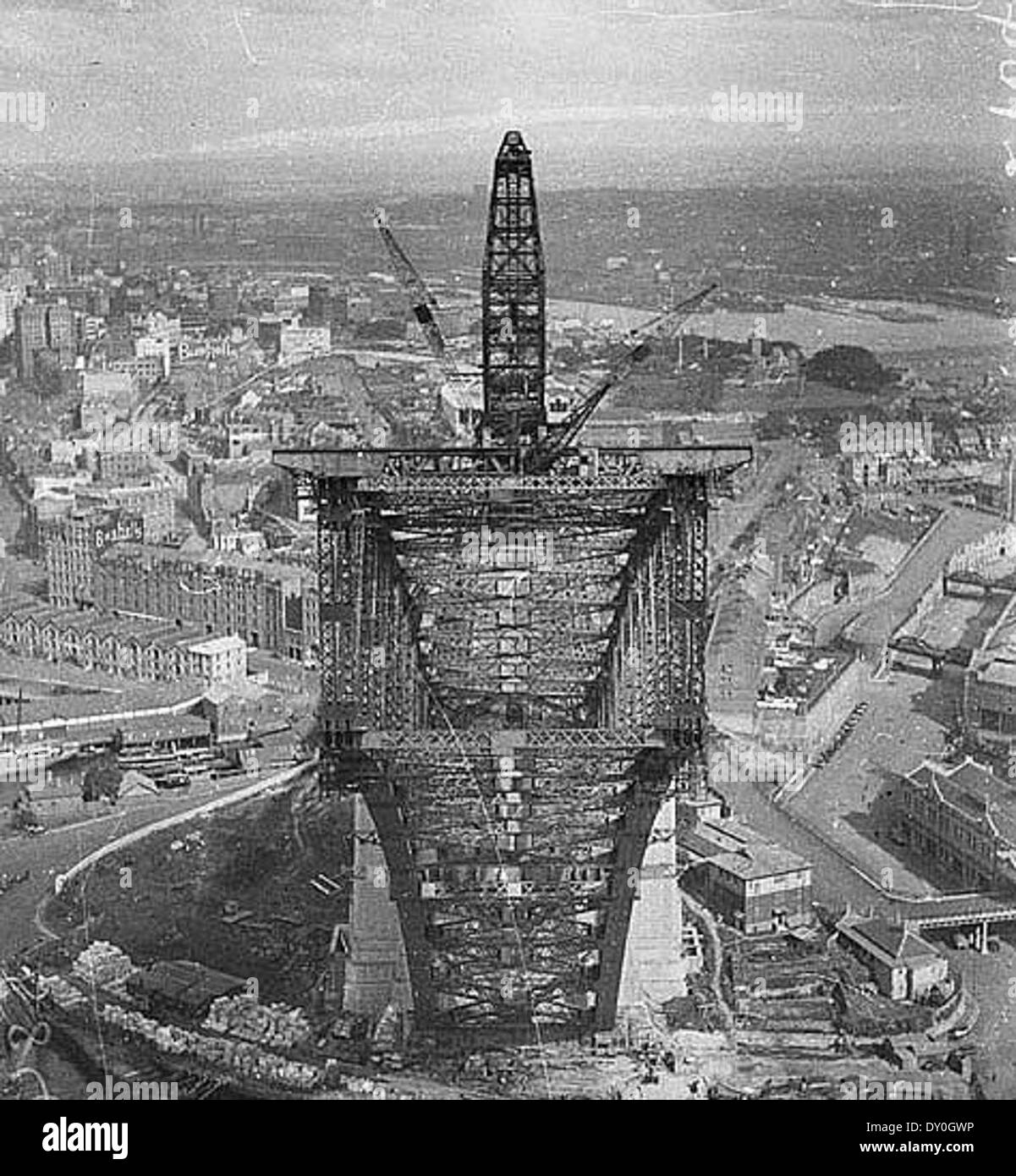 View from pulley-wheels of north side creeper-crane (jibbed right out) looking into box section of south side arch, Sydney Harbour Bridge, May 1930 / Ted Hood (hanging upside down 130 metres - 420 feet - above the harbour.) - Stock Image