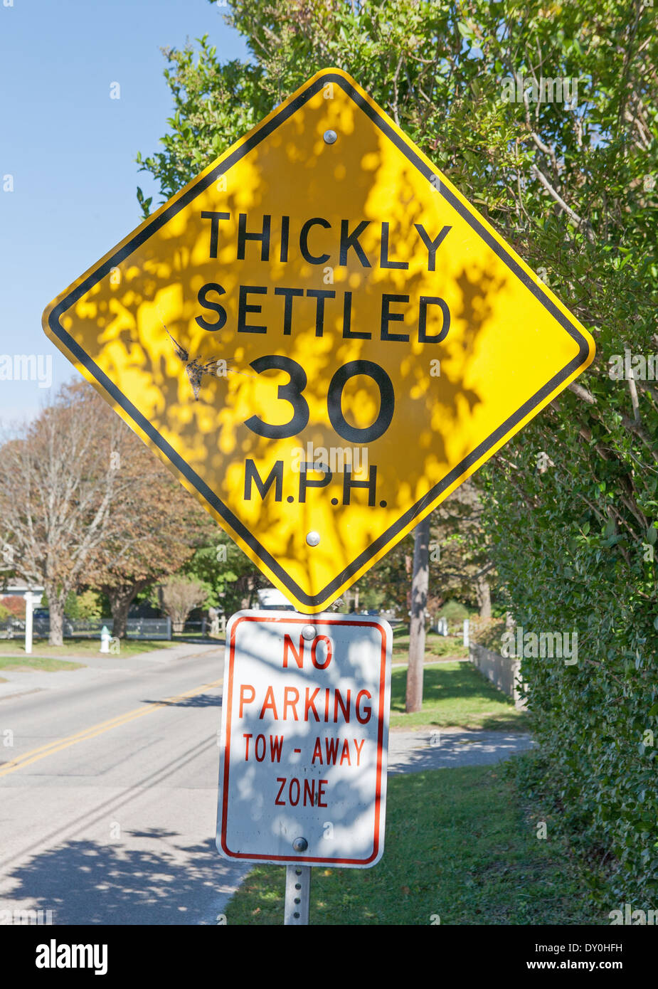 30 mph speed limit sign marked Thickly Settled - Falmouth, New England, USA Stock Photo