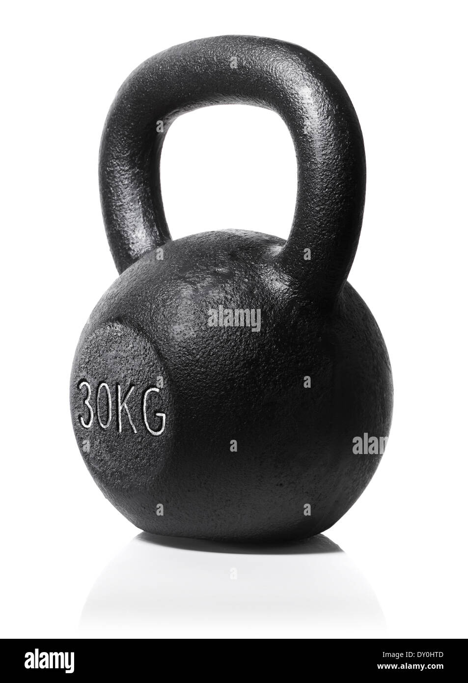 A rough and tough heavy 30 kg 66 lbs cast iron kettlebell isolated on white with natural reflection. - Stock Image