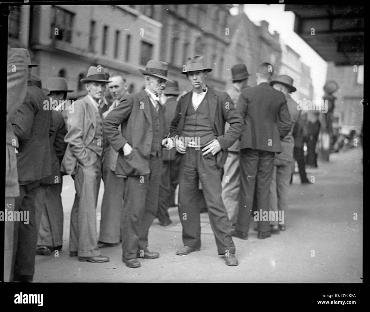 Unemployed carpenters in Phillip Street wait to hear succesful applicant  for one position, 17 June