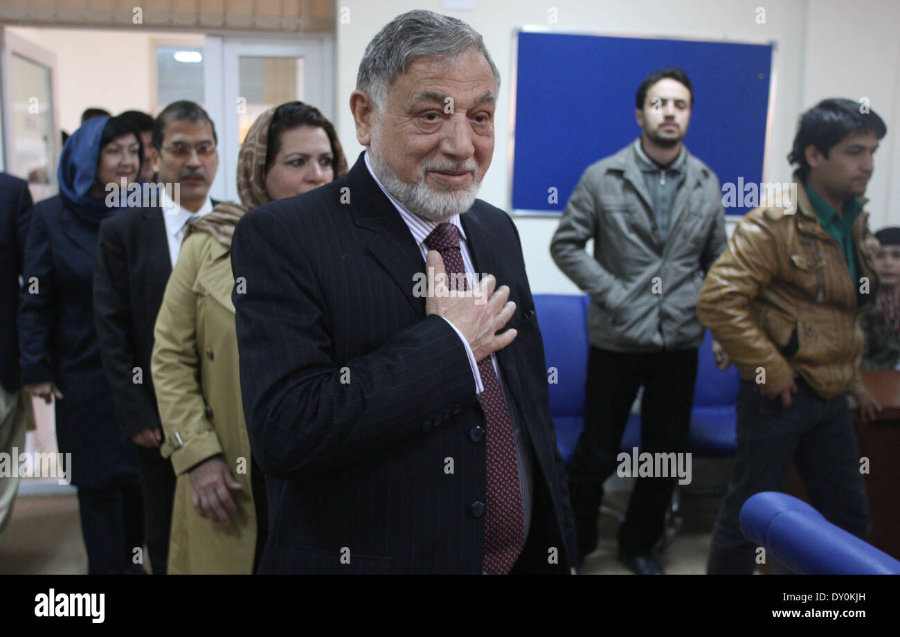 Kabul, Afghanistan. 2nd Apr, 2014. Independent Elections Commission (IEC) chief Ahmad Yousuf Nuristani (C) arrives for a press conference in Kabul, Afghanistan, on April 2, 2014. More than 20 million eligible Afghans will vote for the new president and new provincial assembly members for the next five years, according to the Independent Election Commission (IEC) officials. © Ahmad Massoud/Xinhua/Alamy Live News - Stock Image