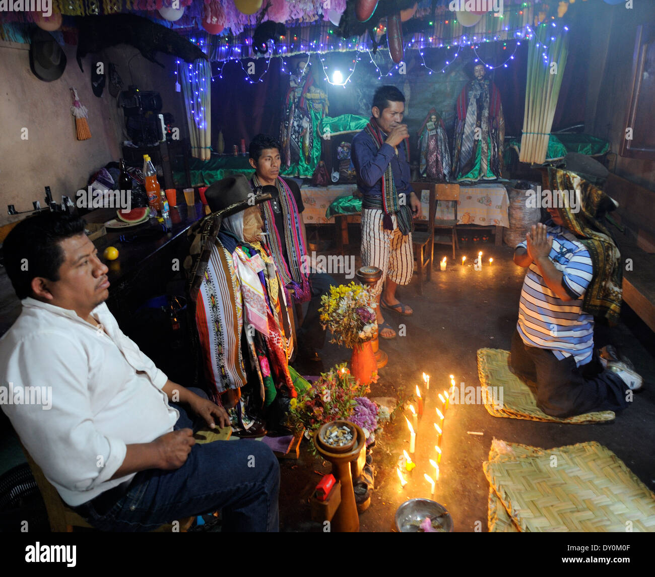 Inside the house of the folk-saint Maximon or San Simon, the evil saint. T - Stock Image