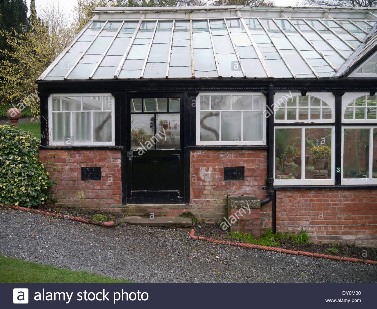 Exterior of a traditionally built greenhouse at Hergest Croft Gardens: Kington. - Stock Image