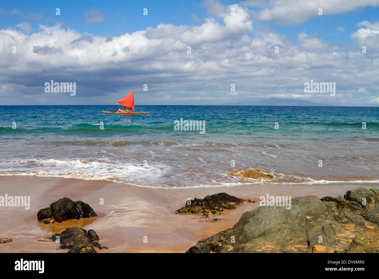 Hawaiian sailing canoe off Maui's south shore; Makena, Maui, Hawaii, United States of America - Stock Image