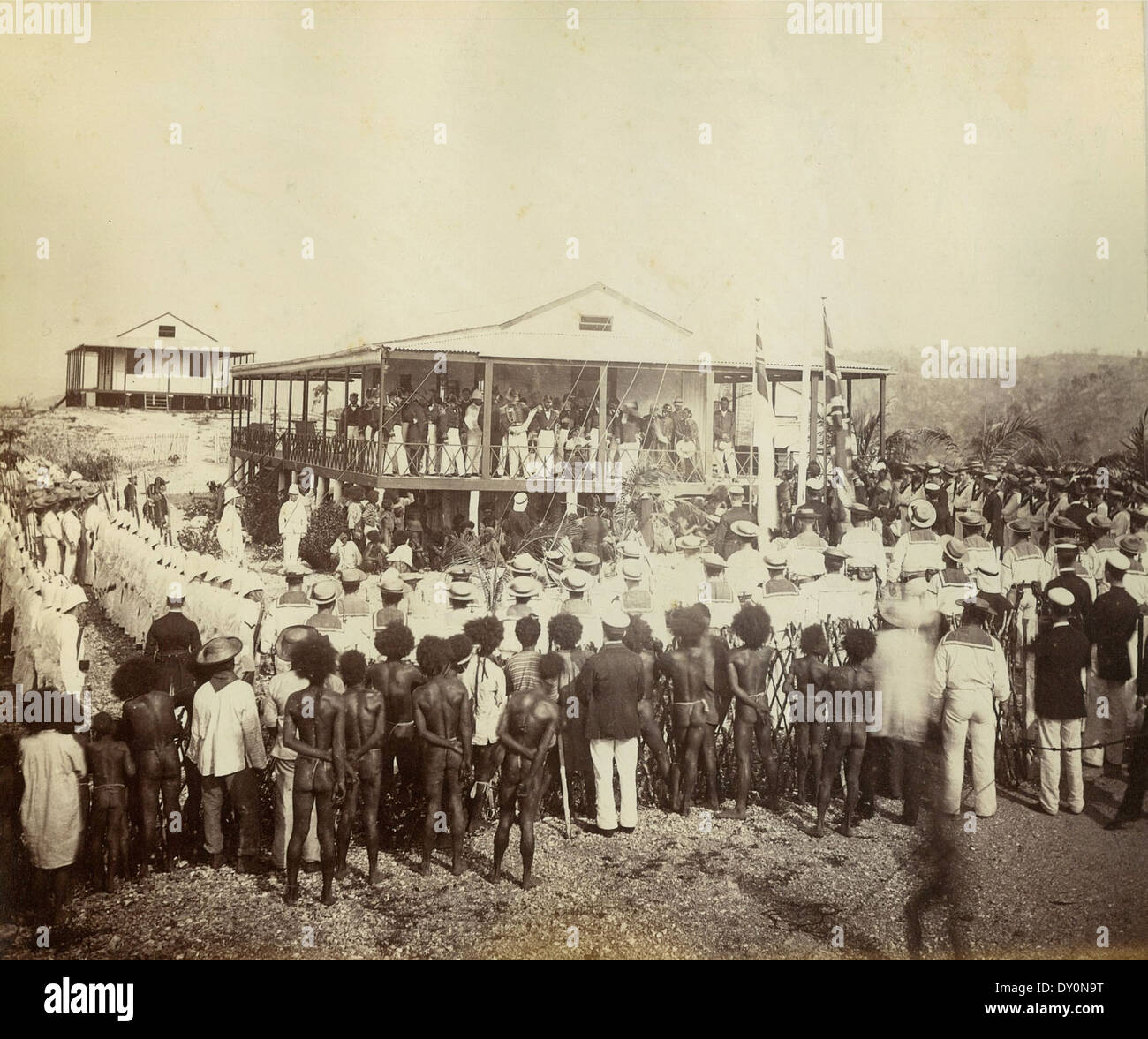 Reading the proclamation of annexation, Mr Lawe's house, Port Moresby, New Guinea, November 1884 / photographer John Paine or Augustine E. Dyer - Stock Image