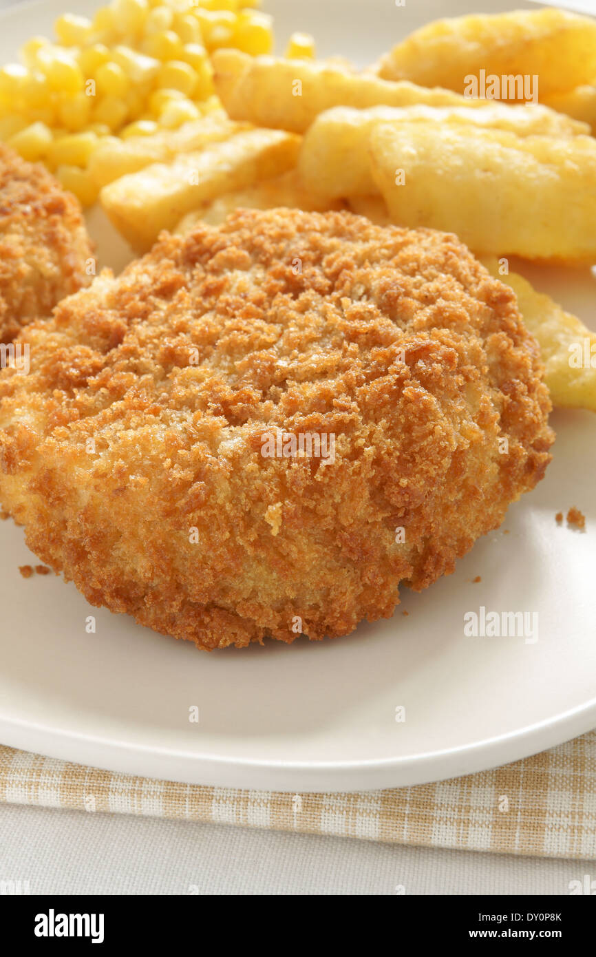 Fishcake with chips and sweet corn - Stock Image