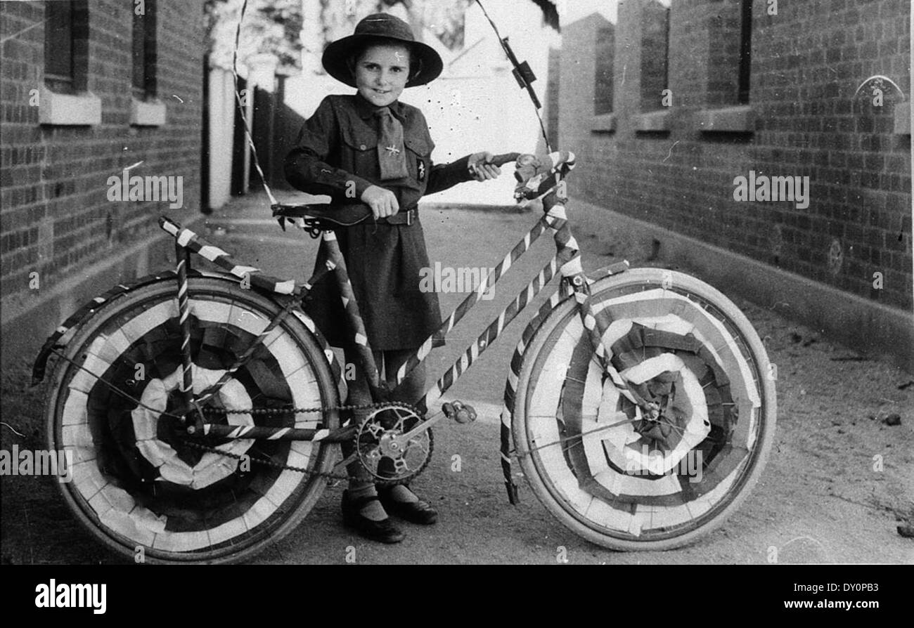 Brownie (Muriel Long) with bicycle decorated for street procession - Deniliquin, NSW, n.d. - Stock Image