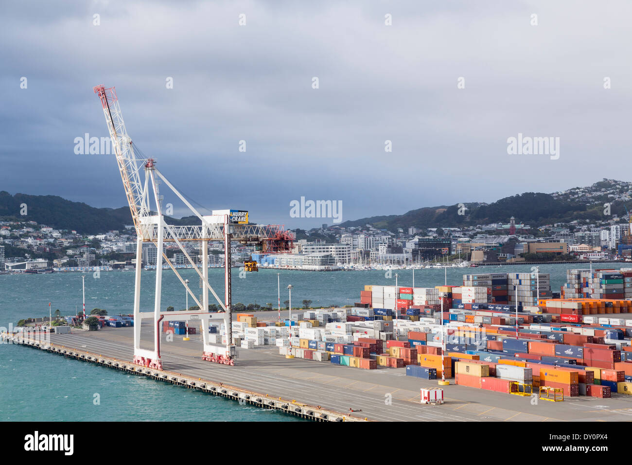 Wellington, New Zealand - Dockside crane and shipping containers in the port - Stock Image