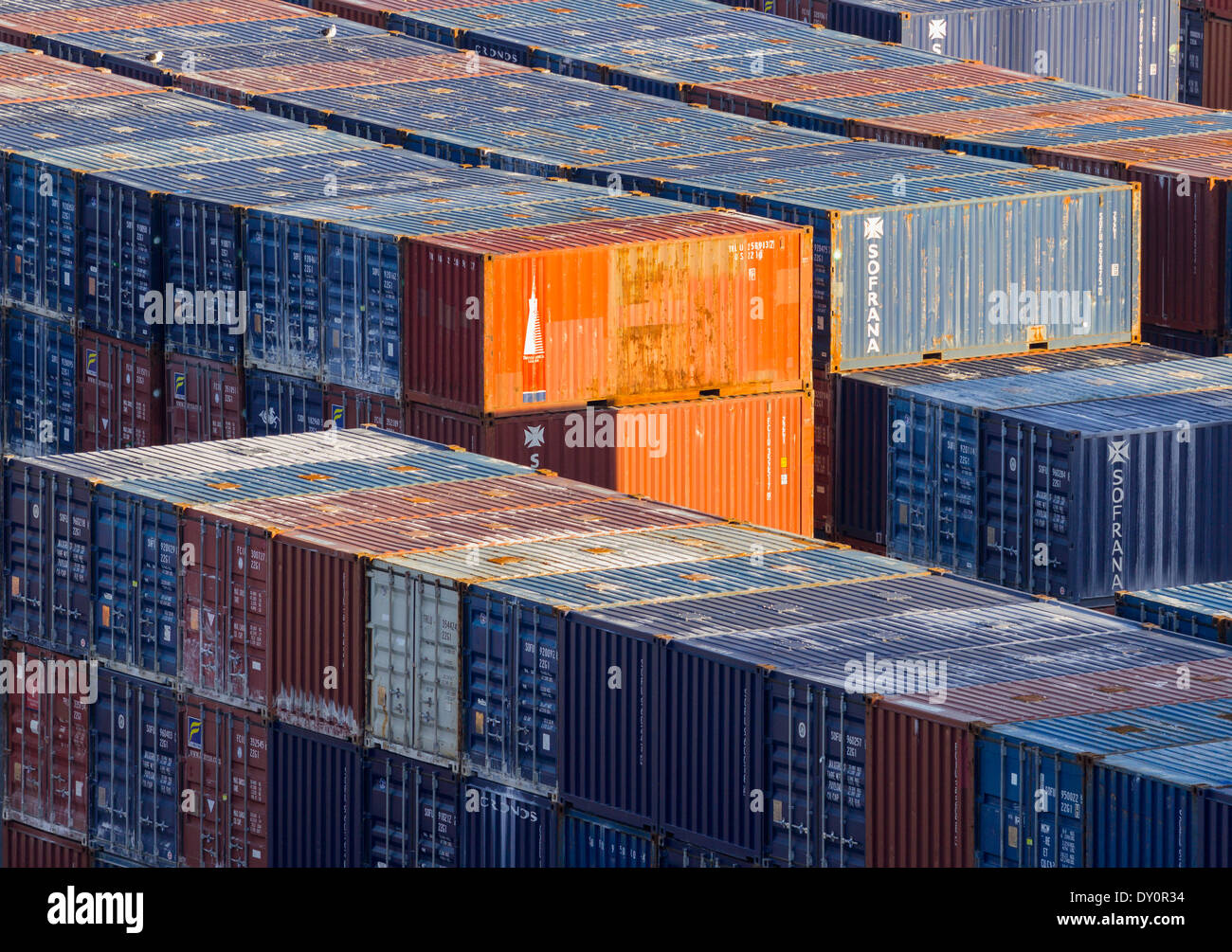 Stacks of industrial shipping containers at a port Stock Photo